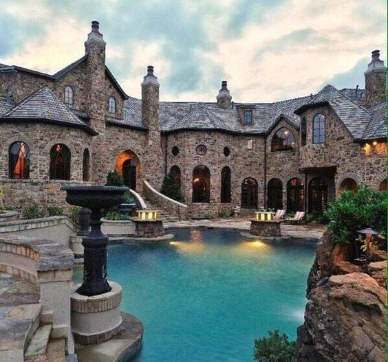 Stone Luxury Mansion and Custom Pool Make for a Dynamic Duo